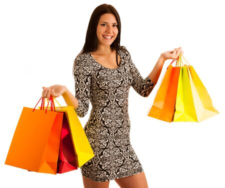 attractive young woman holding shopping bags isolated over white background Stock Photo