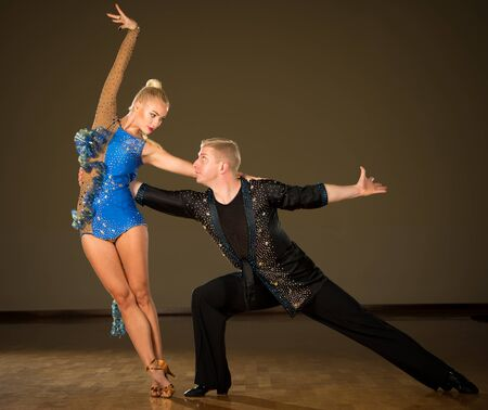 Beautiful professional latin  dance couple preform exhibition dance