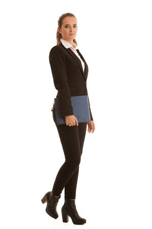 Corporate full length portrait of a preety business woman with blue folder isolated over white background