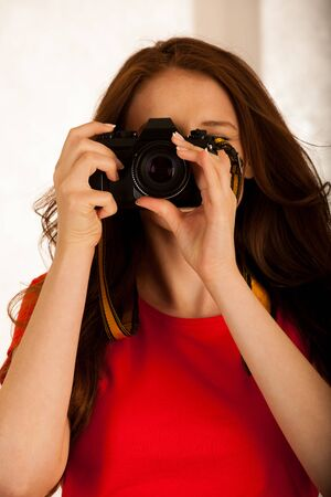 attractive beautiful woman holding a retro camera