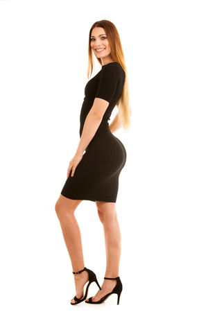 young business woman in black dress isolated over white background full length photography Stockfoto