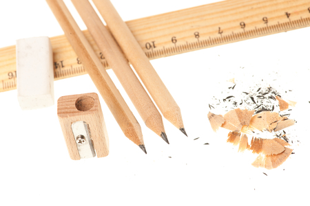 Pencil ruler sharpener and eraser isolated over white background . Stock Photo