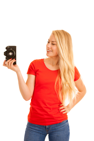 Woman in red with a retro camera isolated over white background
