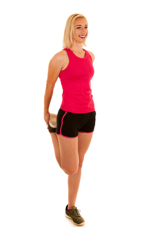 active young woman stretches a leg isolated over white background Stock Photo