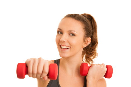 Beautiful young active fit woman workout with dumbbells isolated over white background - fitness Stock Photo