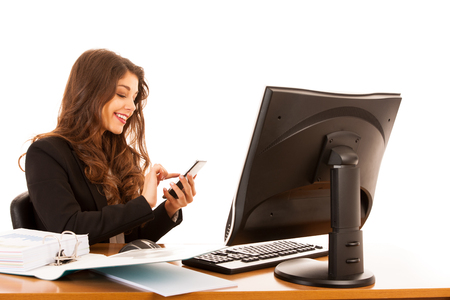 Beautiful young brunette business woman surt internet on her tablet in office Stock Photo