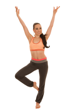 Young woman practice yoga standing isolated over white background . Stock Photo