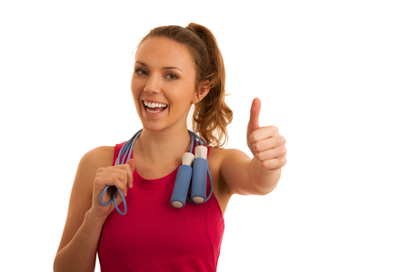 Porrait of beautiful fit active sporty caucasian woman workout with speed rope  isolated over white background Stock Photo