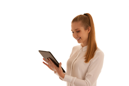 Beautiful business woman surf the internet  on tablet isolated over white Stock Photo