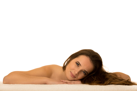 Skin care - beauty portrait of cute caucasian woman lying on table covered with white towel Stock Photo