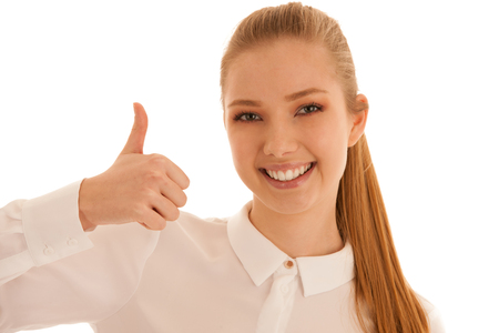 Business woman shows thumb up as a sign for success isolated over white background