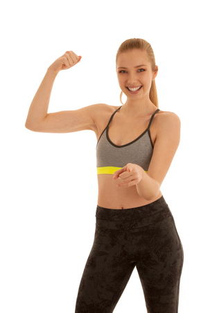 Beautiful fit woman gesture power isolated over white background . Stock Photo