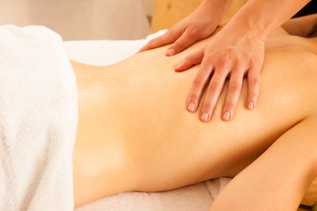 Body care. Spa body massage treatment. Woman having massage in the spa salon Stock Photo