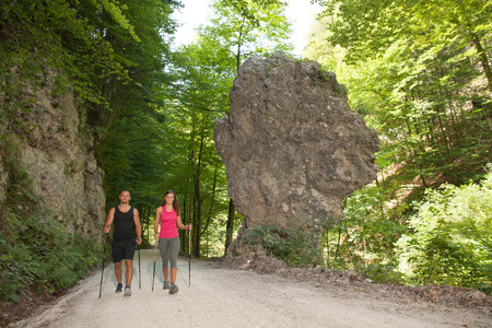 Young couple on a hike at rock formation on a hot summer day Stock Photo