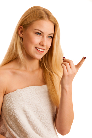 skin care - beautiful young woman nurturing her skin isolated over white background Stock Photo