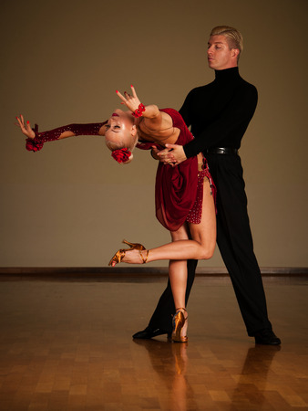 latino dance couple in action  preforming a exhibition dance - wild samba Stockfoto