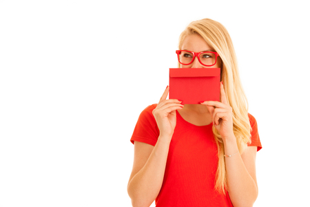 Beautiful young woman holds red envelope  - a love letter for valentines day Stock Photo