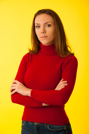 creaqtive portrait of a beautiful young caucasian happy woman in red wool kneeted sweater