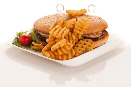 Gamburger with frenchfries on a plate isolated over white background