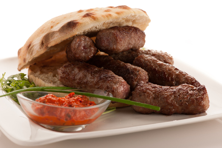 photo of Cevapi, cevapcici, traditional Balkan food - delicious minced meat  .