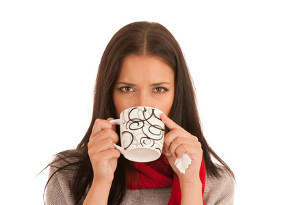 ill woman drinks tea isolated over white background