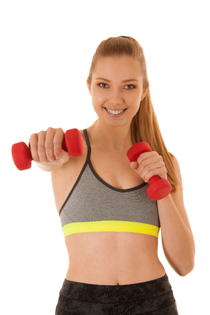 Beautiful young fit woman works out with dumbbells isolated over white background Stock Photo
