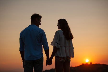 Silhouette of a beautiful romantic couple at sunset