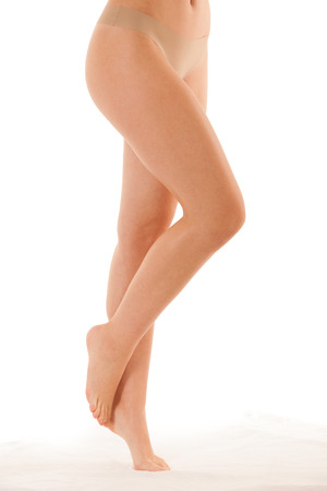 Beautiful long slim and elegant woman legs isolated over white background