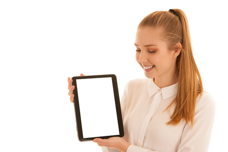 Beautiful business woman shows blank monitor on tablet isolated over white Banco de Imagens