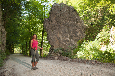 Woman on a hike at rock formation on a hot summer day