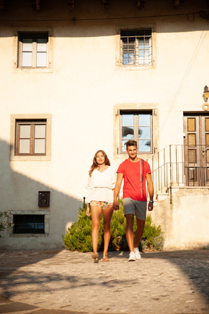 Young couple exploring ancient village Smartno in slovenia in early summer