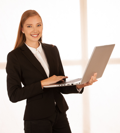 corporate Portrait of a young business woman working on laptop . Reklamní fotografie