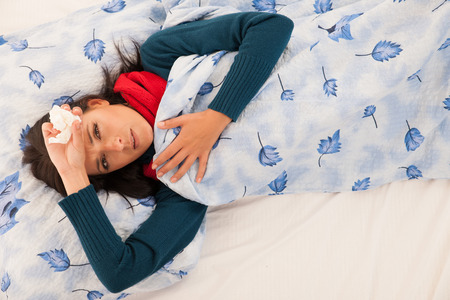 Young ill woman has headache isolated over white background .