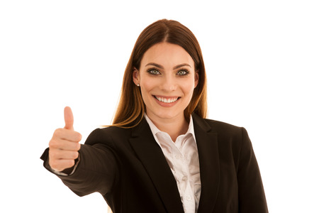 Attractive business woman showing thumb up as a gesture for success isolated over white background
