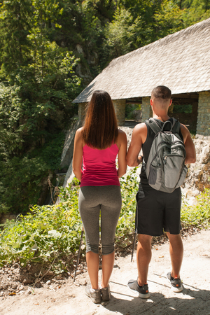 Active young couple on a hike in forest on a hot wummer day