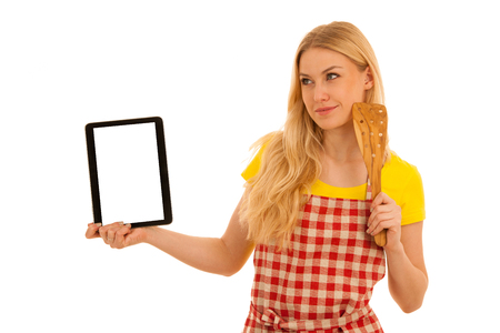 Young blond woman chef showing tablet with a recepy isolated over white background Stock Photo