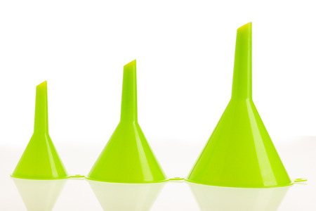 Three green funnels islated over white .