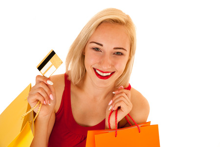 Attractive blonde young woman with shopping bags isolated