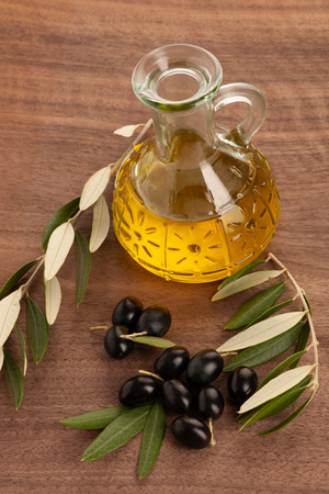 Bottle of olive oil isolated over white background .