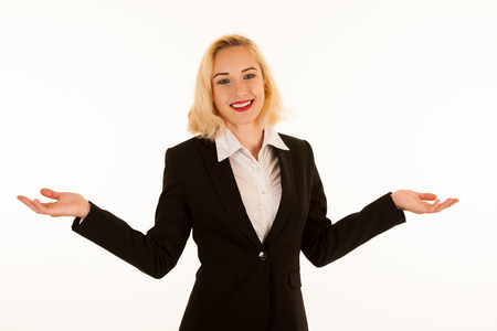 Attractive beautiful young blonde woman pointing into copyspace when advertising a product