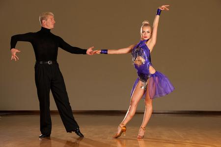 latino dance couple in action  preforming a exhibition dance - wild samba Stock Photo