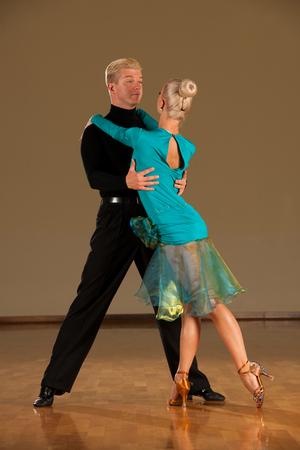 latino dance couple in action  preforming a exhibition dance - wild samba Stok Fotoğraf