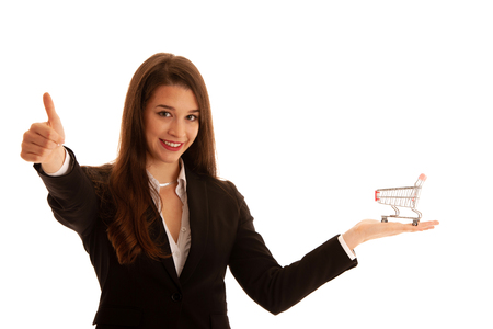 Beautiful business woman holds shopping cart isolated over white background Banque d'images