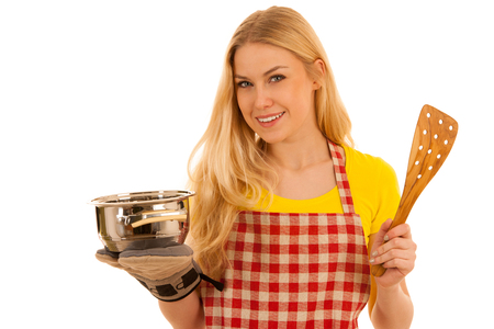 young blond woman cooking isolated over white background
