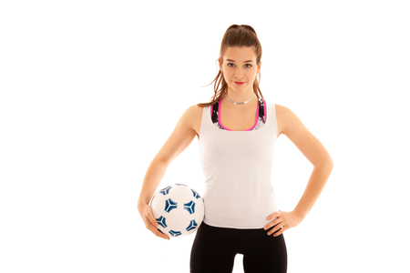 Woamn soccer player holds a ball isolated over white background . Stockfoto