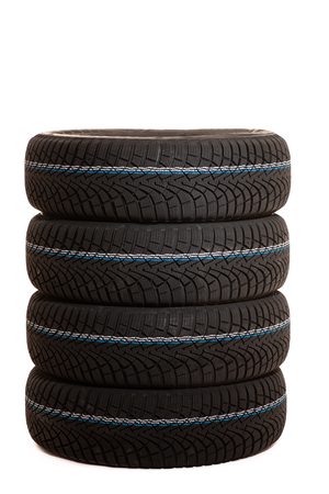 New winter tires isolated over white