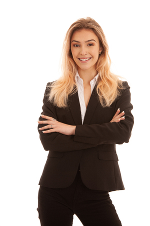Beautiful blond young business woman in black suit isolated over white
