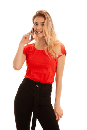 Beautiful young woman in red t shirt speak on a smart phone isolated over white background - phone chat