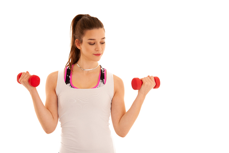 Beautiful young athlete woman workout with dumbbells isolated over white background Stock Photo