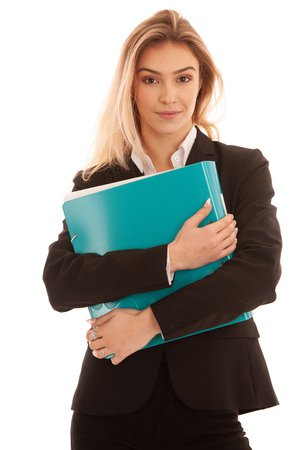 Beautiful young business woman in black suit holds business file folder isolated over white